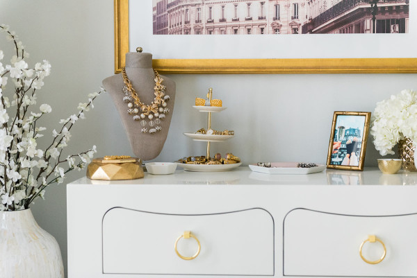 Blogger Jessica Sturdy of @bowsandsequins shares her Chicago Parisian-chic bedroom design. Paris buildings art print, Bungalow 5 White and Gold Jacqui Dresser.