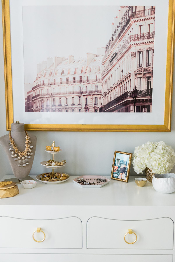 Blogger Jessica Sturdy of Bows & Sequins shares her Chicago Parisian-chic bedroom design. Necklace bust display with gold and pearl jewelry.