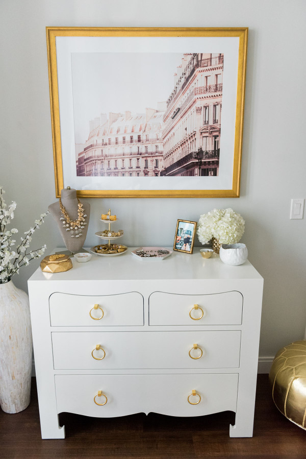 Blogger Jessica Sturdy of Bows & Sequins shares her Chicago Parisian-chic bedroom design. Gold bamboo frame, white hydrangeas, CB2 colada vase.