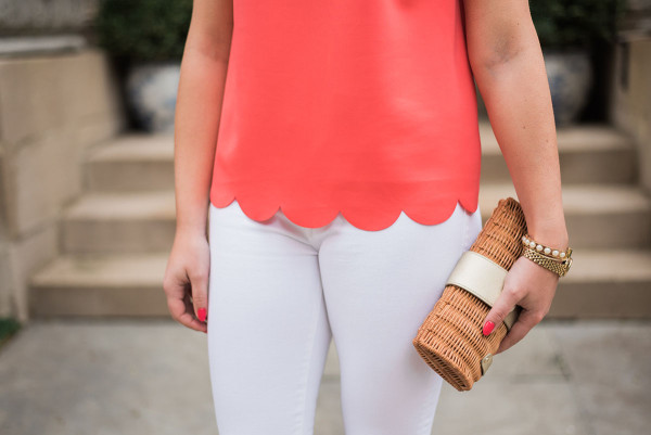 coral scalloped hem top, white jeans, wicker clutch