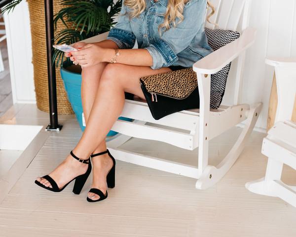denim jacket, black romper, black ankle strap heels, leopard clutch, what to wear for girls night out ideas