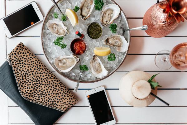 oysters hampton social chicago leopard clutch