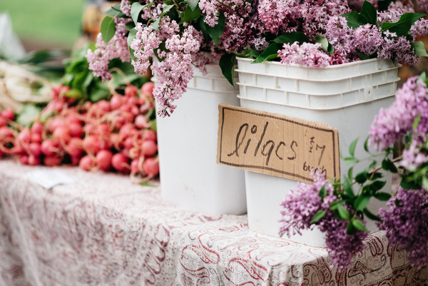 Purple lilacs at Green City Market outdoor farmers market in Lincoln Park in Chicago.