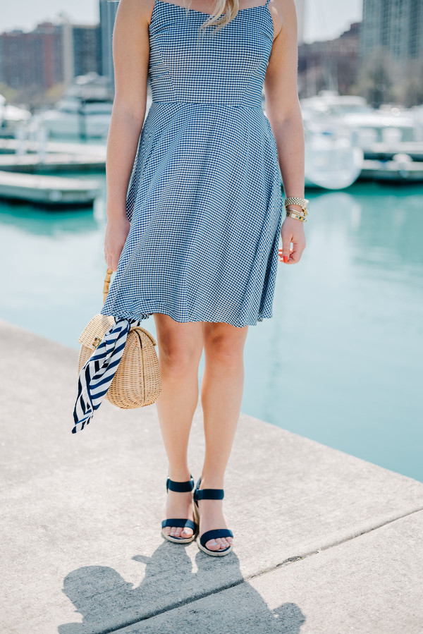 Bows & Sequins at Belmont Harbor in Chicago wearing a blue Old Navy gingham dress, Ralph Lauren navy wedges, a J.McLaughlin wicker tote, and a Kate Spade striped silk scarf.