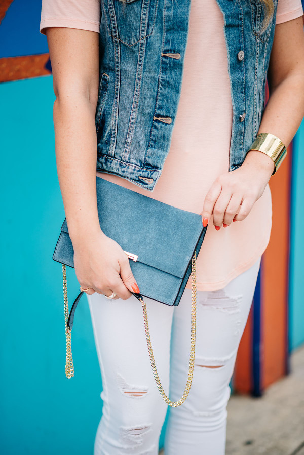 ivanka trump crossbody bag gold chain strap, white ripped jeans, coral tee shirt