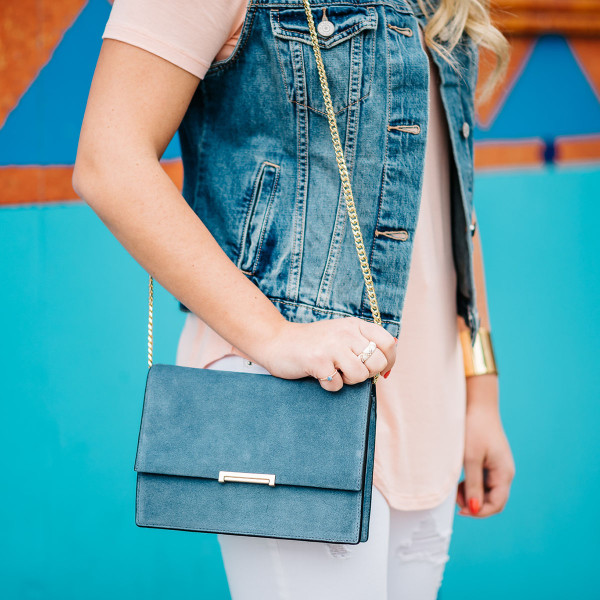 ivanka trump handbag, blue suede crossbody bag, gold chain strap, denim vest outfit