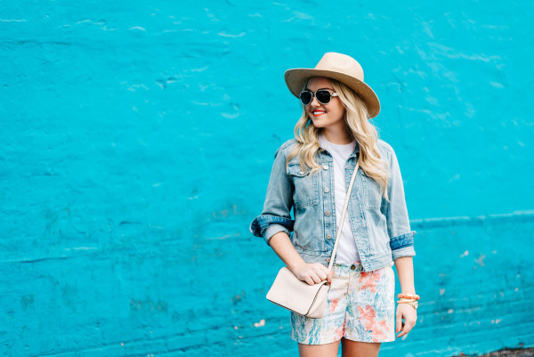 jean jacket, colorful printed shorts, straw sun hat, pink crossbody bag