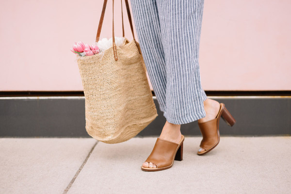 leather mules, straw farmers market tote, blue and white linen pants, tulips