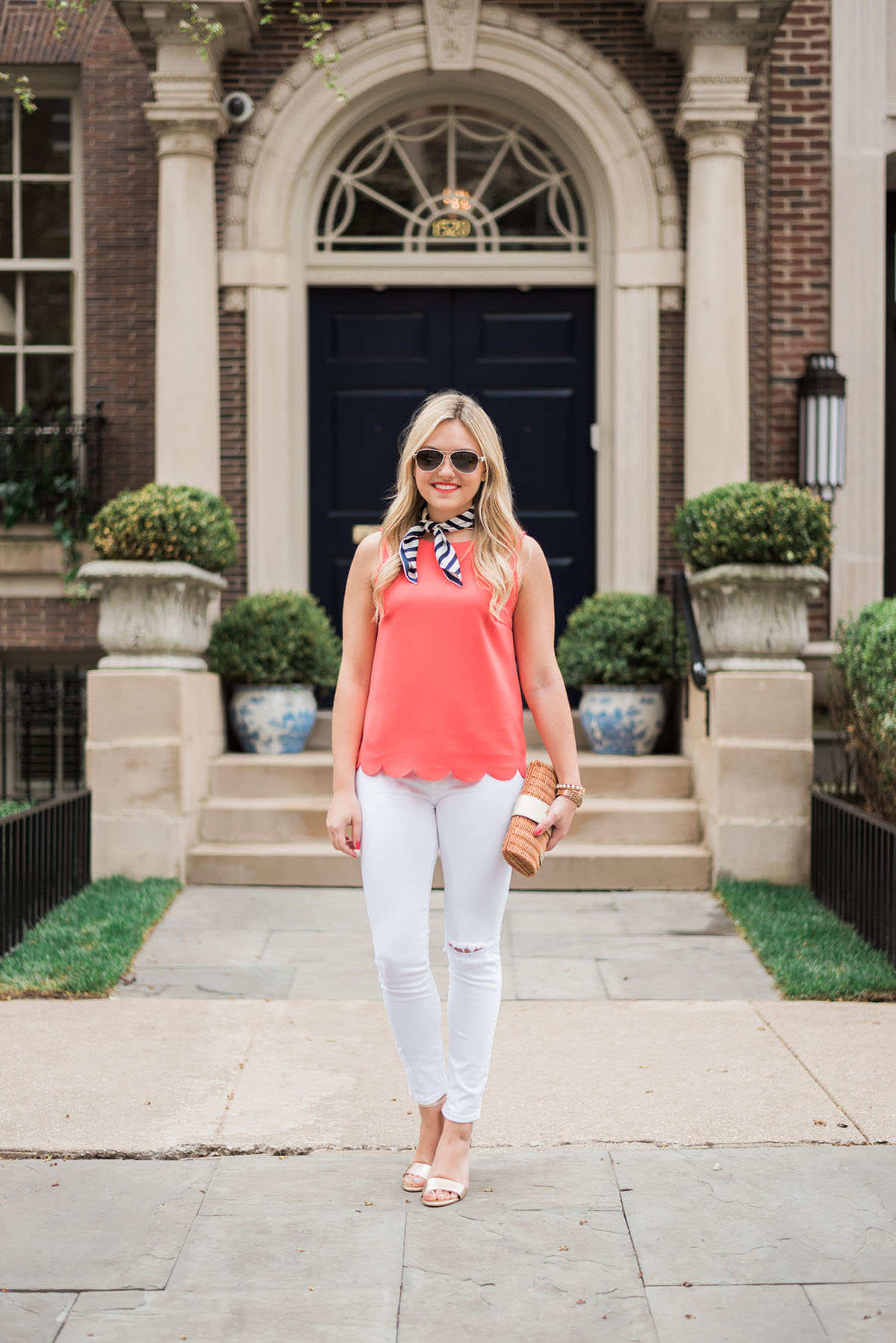 navy and white striped silk scarf, coral scalloped tank top, white jeans, gold wedges, wicker clutch