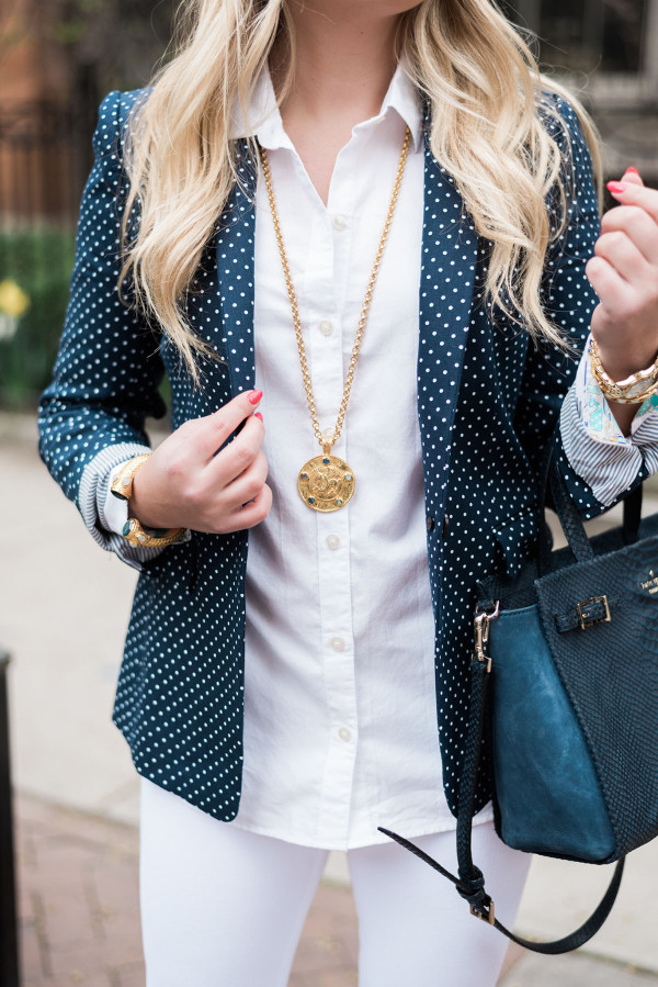 Bows & Sequins wearing a J.Crew polka dot blazer, Vineyard Vines oxford shirt, Kate Spade navy blue handbag, and Julie Vos jewelry.