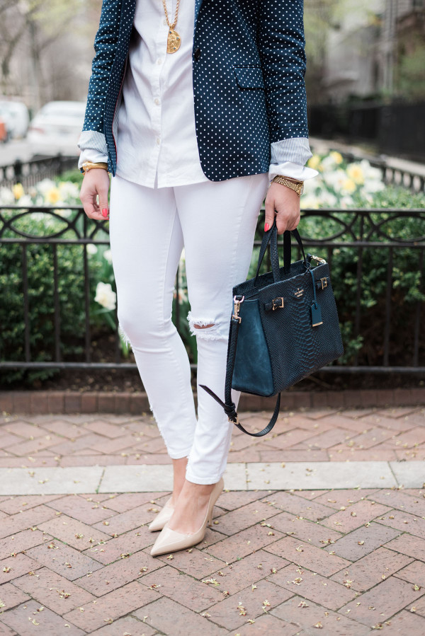 Fashion blogger showing how to wear white jeans to the office.