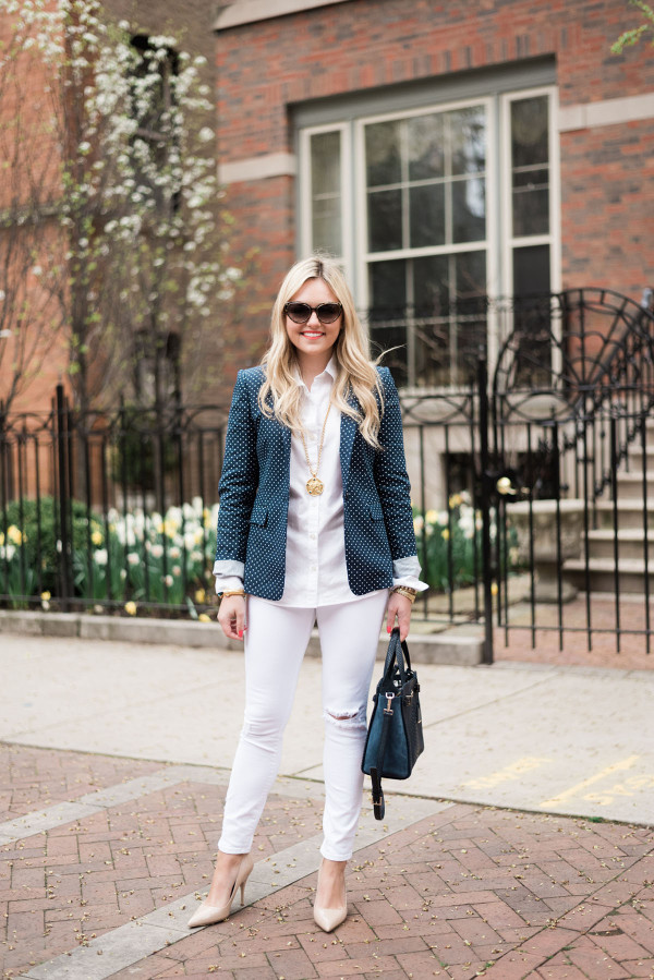 Fashion blogger, Jessica Sturdy of bows & sequins, wearing a polka dot blazer and white denim jeans.