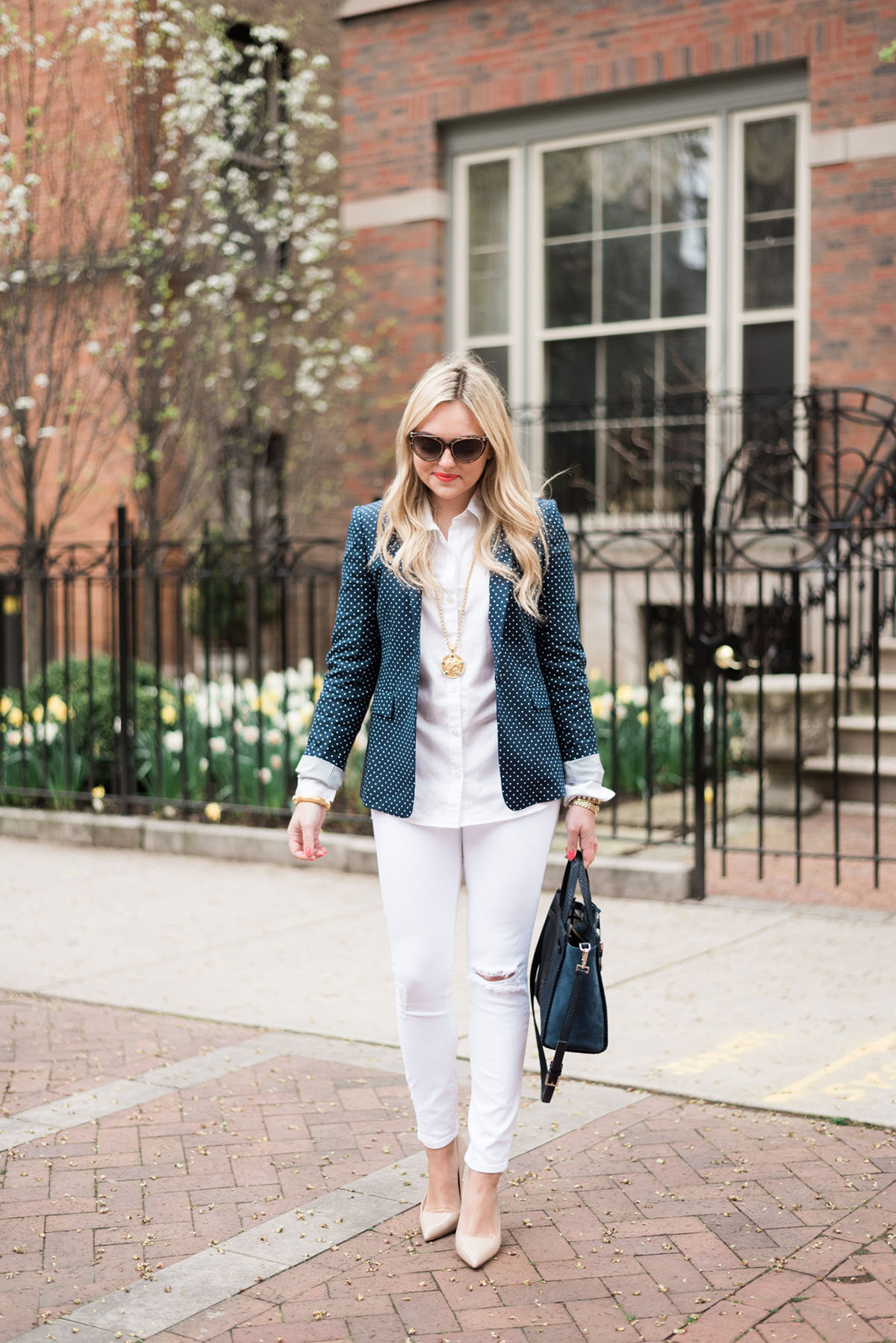 Fashion blogger, Jessica Sturdy of bows & sequins, styling an office-appropriate springtime outfit with white jeans.