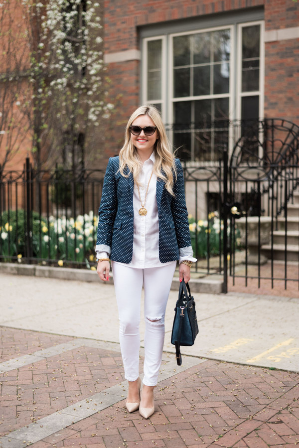 Fashion blogger, Jessica Sturdy of bows & sequins, styling an office-appropriate springtime outfit with a polka dot blazer and white jeans.