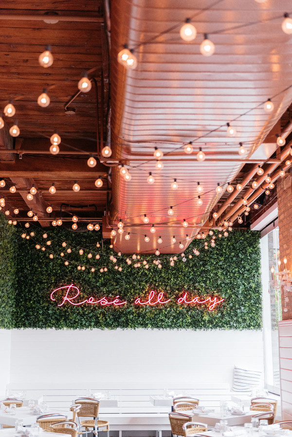 Rosé All Day neon sign at The Hampton Social in Chicago. Bows & Sequins favorite French rosé wines.