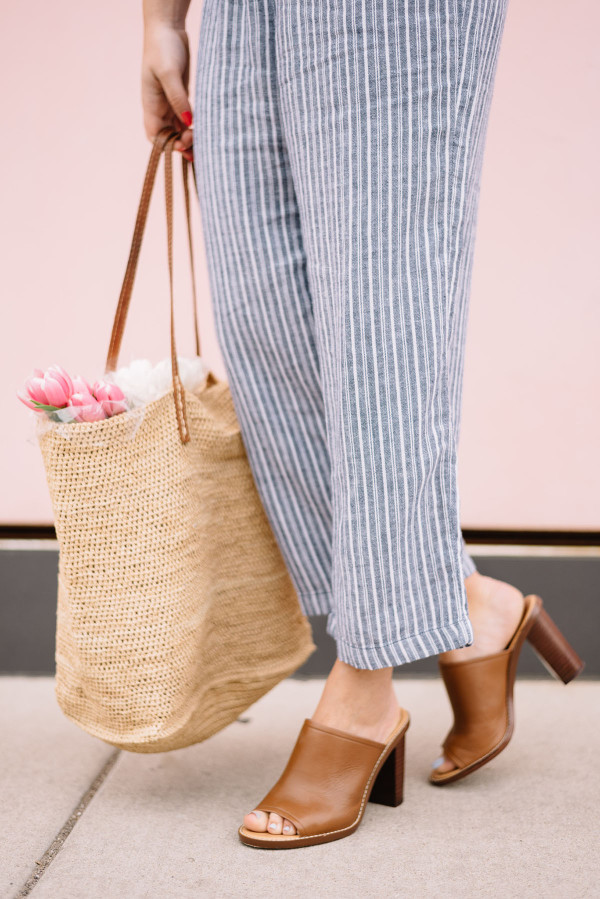 straw tote, leather mules, linen pants