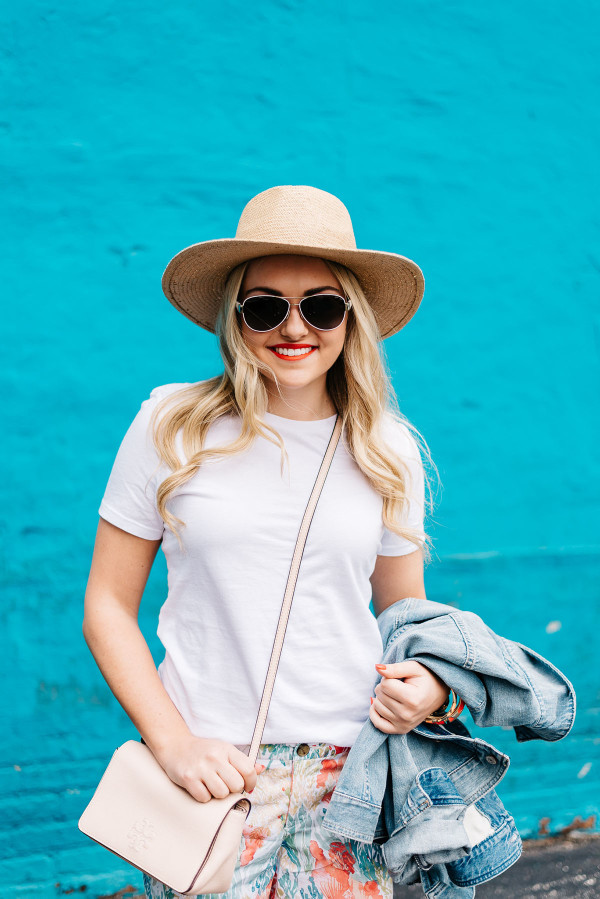 summer outfit ideas white tee shirt, straw hat, denim jacket, crossbody bag