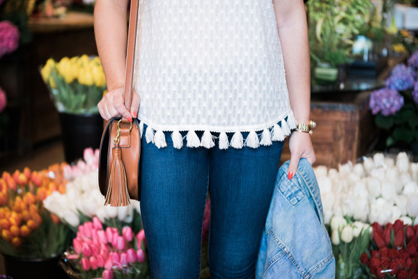Fashion blogger, Jessica Sturdy, inside of A New Leaf flower shop on Wells Street in Lincoln Park in Chicago. She's wearing an Old Navy tassel top, J Brand jeans, and an Express denim jacket.
