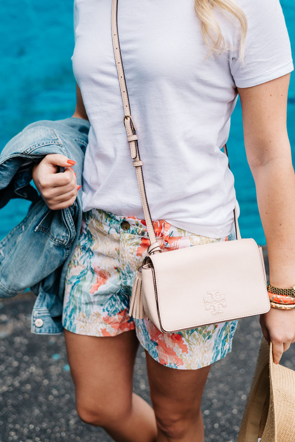 tory burch crossbody handbag tassel blush pink, old navy printed shorts, white tee shirt, summer concert outfit