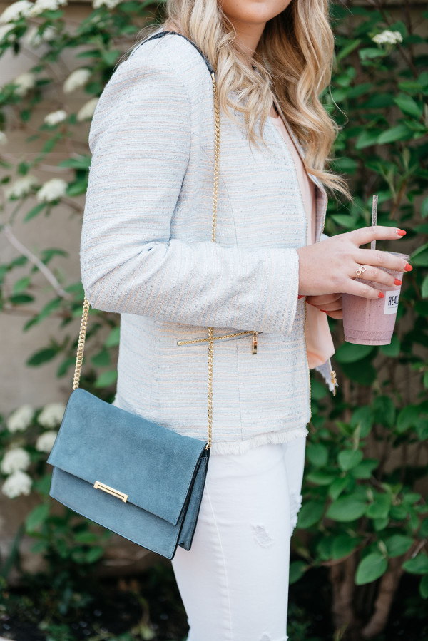 Bows & Sequins swearing a metallic tweed jacket and a blue suede Ivanka Trump cross-body bag with a gold chain.