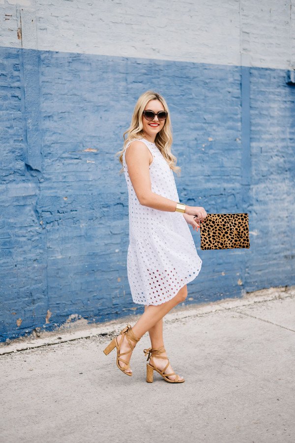 white dress, tan sandals, leopard clutch
