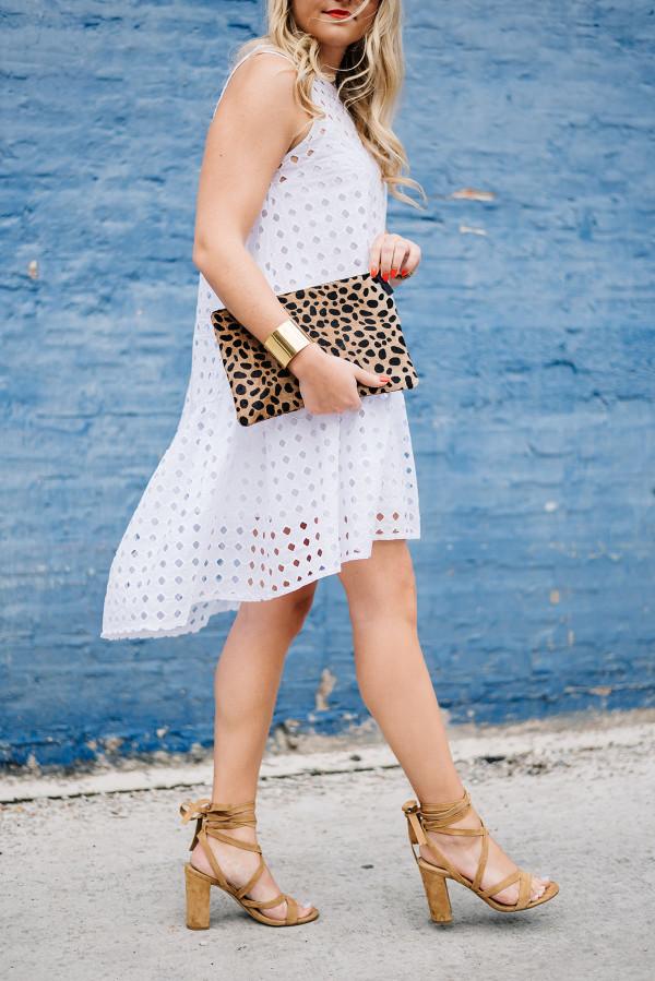 white eyelet dress high low hem, leopard clutch, ivanka trump sandals