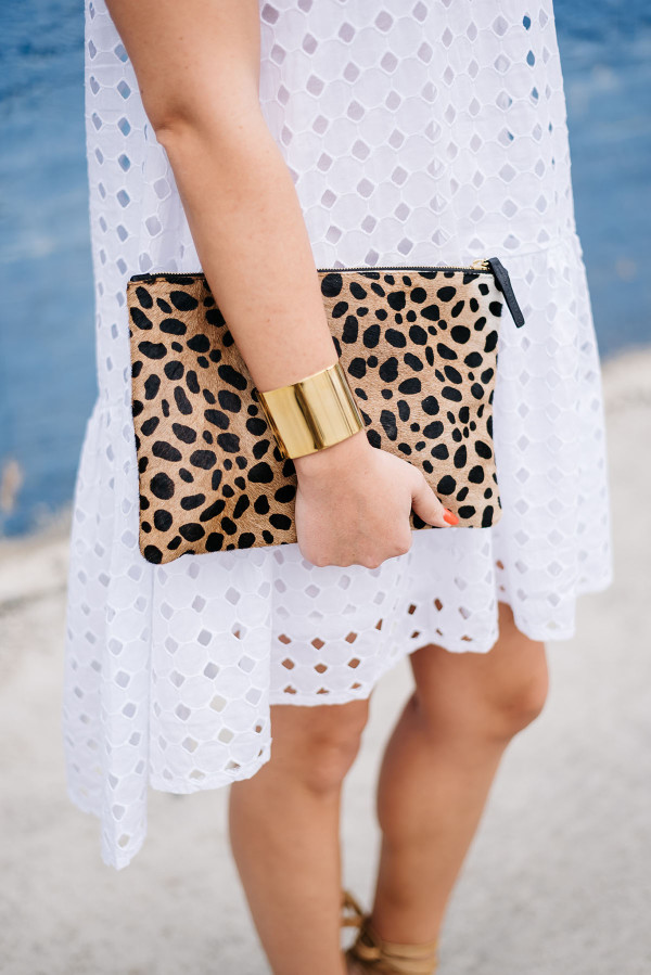 white eyelet dress, leopard clutch, gold cuff