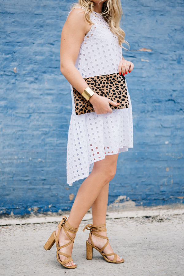 white eyelet dress with leopard clutch and lace up heels