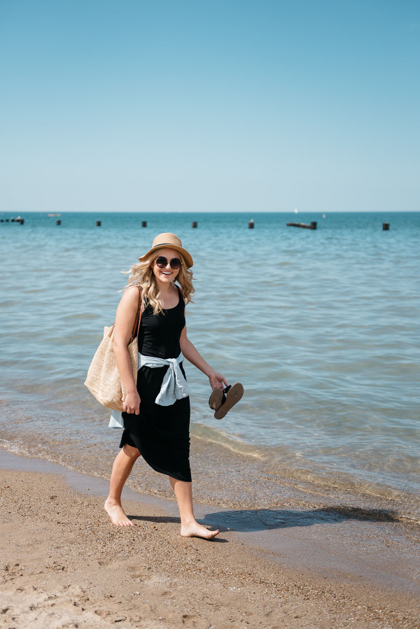 Bows & Sequins at North Avenue Beach in Chicago wearing a black maxi dress and chambray shirt.