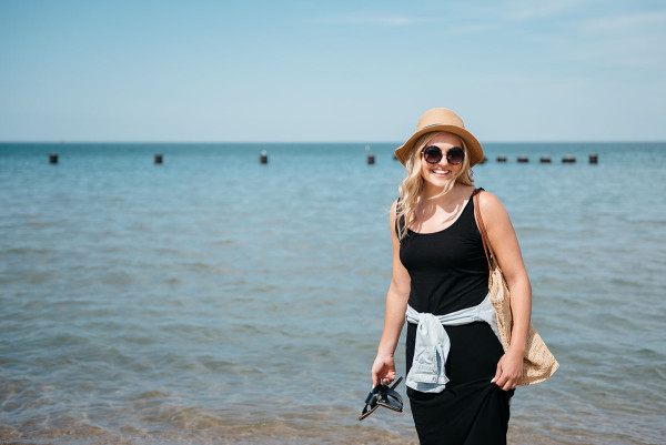 Sequins at North Avenue Beach in Chicago wearing a black maxi dress and chambray shirt.