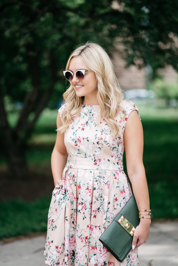 Bows & Sequins wearing a peach floral dress from Modcloth for a summer wedding.