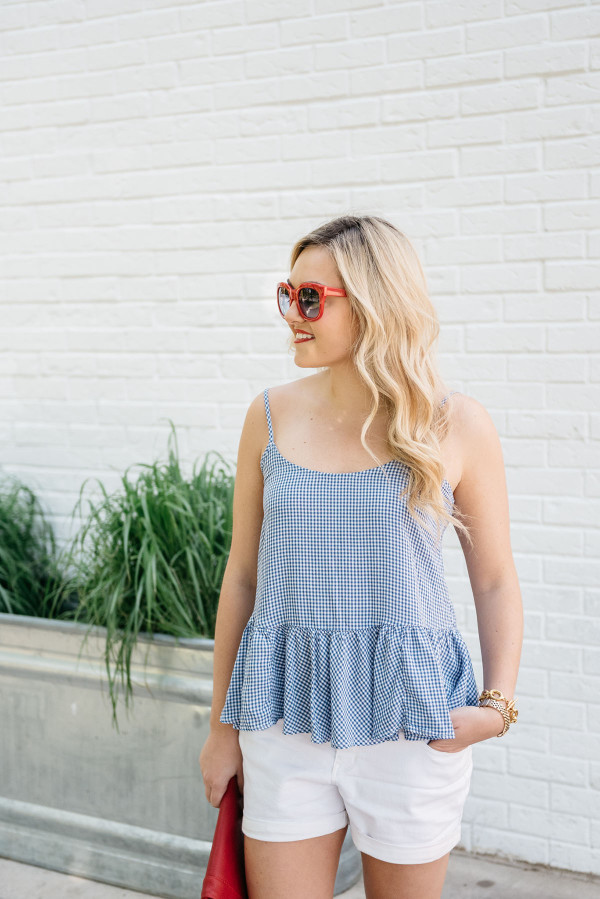 Bows & Sequins visits Parson's Chicken and Fish in Chicago. Jessica is wearing a blue and white Old Navy gingham top, white jeans shorts, red and blue gingham flats from Souther Proper, a red Sole Society clutch, and red sunglasses. A good outfit for Fourth of July weekend!