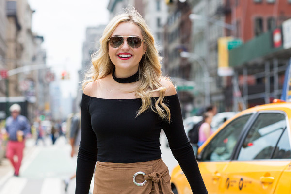 Bows & Sequins wearing a black off-the-shoulder crop top with a black choker in NYC.