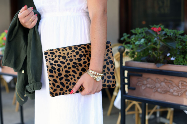 Bows & Sequins wearing a white maxi dress that's perfect for summer vacations! Dress it up at night with wedges and a printed leopard clutch. This calfhair clutch is from Clare V!