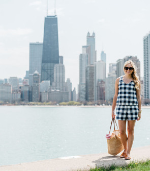 Bows & Sequins wearing a gingham short set having a picnic at North Avenue Beach with the Chicago Skyline in the background.