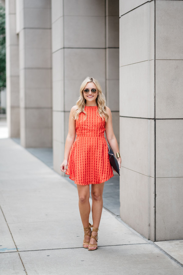 Bows & Sequins wearing a Lovers + Friends red-orange backless dress. Perfect dress for a warm night out on the town!