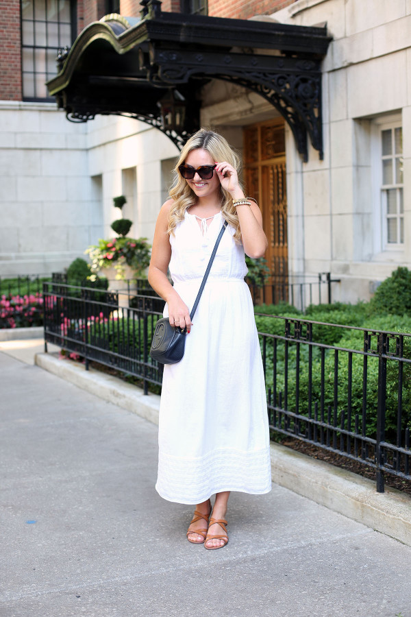 Bows & Sequins wearing a white maxi dress that's perfect for summer vacations! Dress it up at night with wedges and a printed clutch or keep it casual for sightseeing with a crossbody and a pair of flat leather sandals.