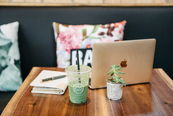Left Coast Food in Chicago is one of @bowsandsequins' favorite spots for healthy eating and working remotely. Jessica's workday essentials are pictured here: a GigiNY leather journal and a gold Apple Macbook.