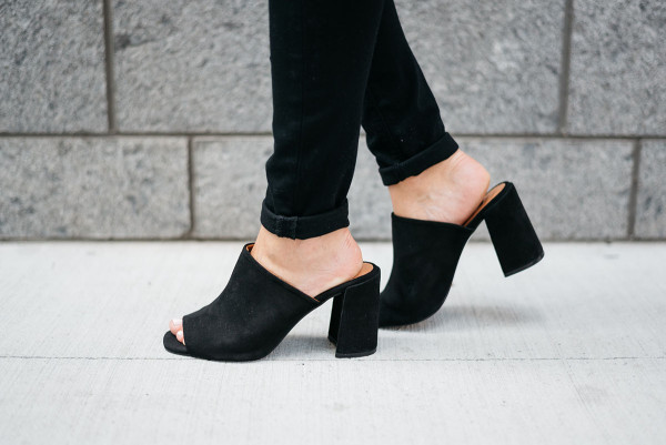 Bows & Sequins wearing a pair of black suede peep-toe mules from Topshop.
