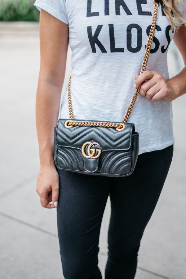 Bows & Sequins wearing a black leather Gucci bag with a gold chain strap and the new retro logo.