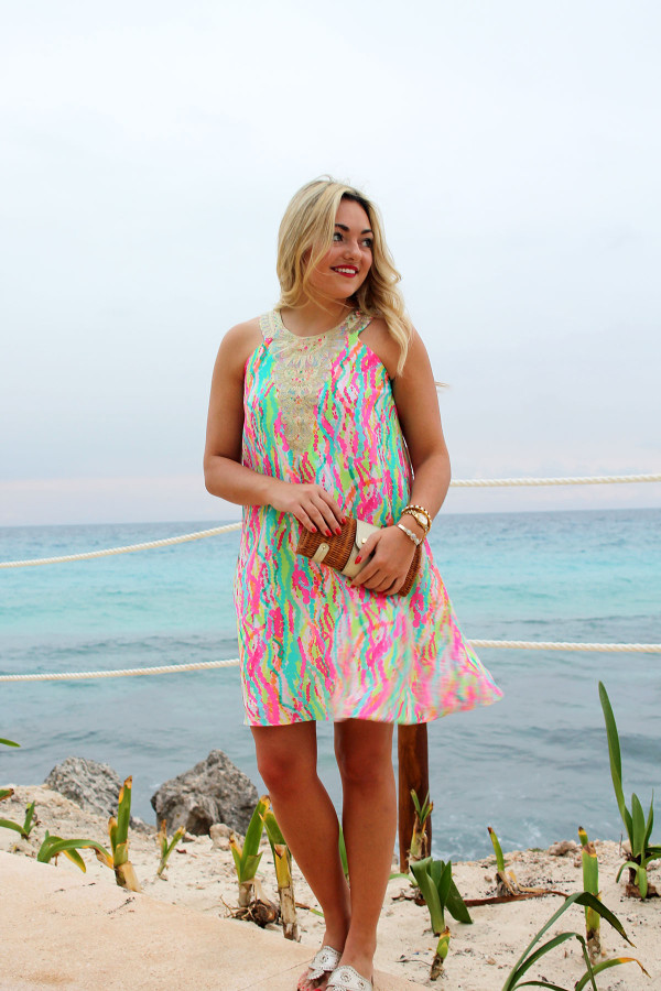 Bows & Sequins wearing a colorful Lilly Pulitzer dress at a beachfront resort in Mexico.
