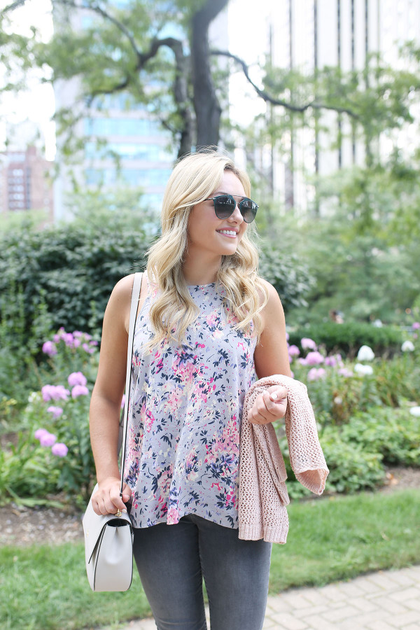 Bows & Sequins wearing a floral paisley-printed top from Old Navy, a Kate Spade crossbody bag, and Dior sunglasses.