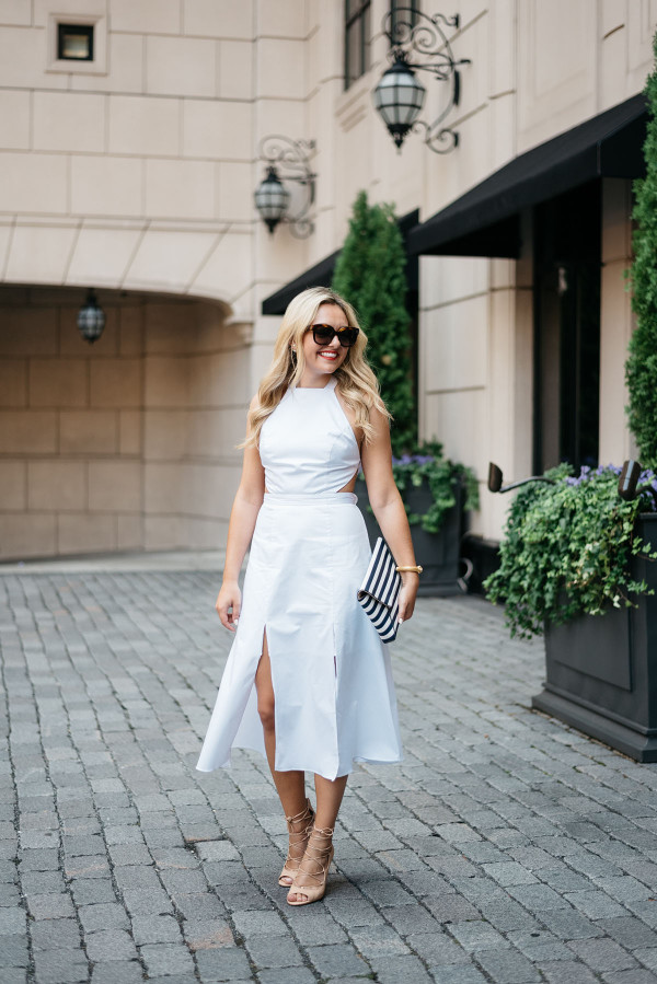 Style blogger Bows & Sequins wearing a white dress, black and white purse, and Celine sunglasses.