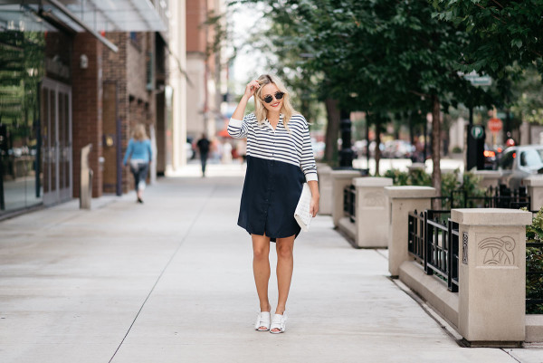 Jessica Sturdy of the fashion blog Bows & Sequins styling a COS striped t-shirt dress, white bow shoes, sunglasses and a white purse.