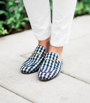960b9df13 Bows & Sequins wearing a pair of navy gingham Gucci Princetown slip-on  loafers.