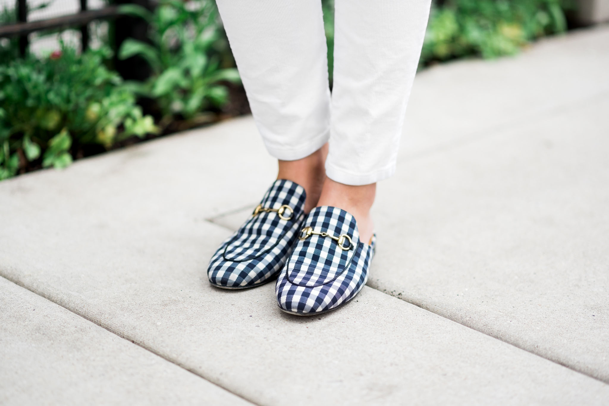 Bows & Sequins wearing a pair of navy gingham Gucci Princetown slip-on loafers.