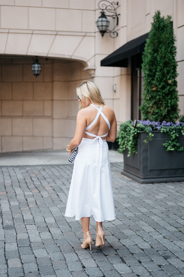Jessica Sturdy of Bows & Sequins wearing a crisscross white dress in Chicago.