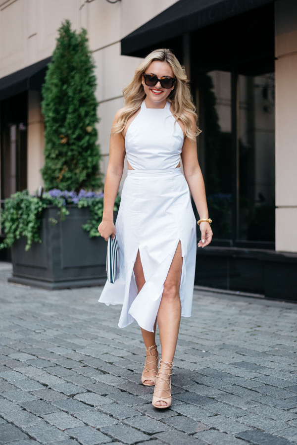Jessica Sturdy of Bows & Sequins, fashion-focused lifestyle blog, wearing a white Fame and Partners dress, Celine sunglasses, and a clutch purse in Chicago.