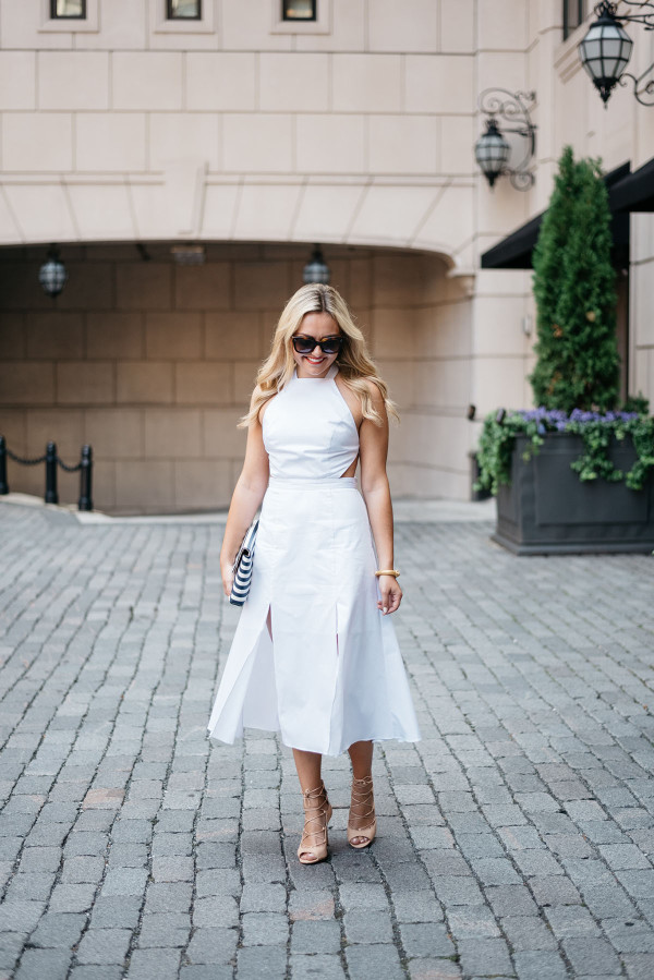 Bows & Sequins, fashion-focused lifestyle blog, styling a white dress, Celine sunglasses, and black and white striped clutch purse in Chicago.