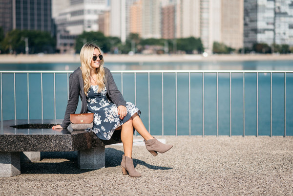Bows & Sequins, fashion blogger, wearing a navy dress, grey long sweater, clutch purse, and aviator sunglasses in Chicago.